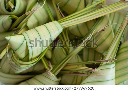 Asian cuisine ketupat or packed rice.  - stock photo