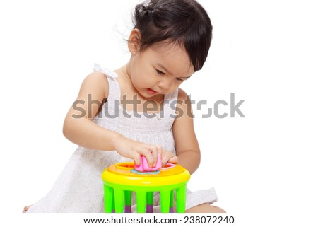 Asian cute baby girl is playing a colorful box shape matching toy isolated on white background - stock photo