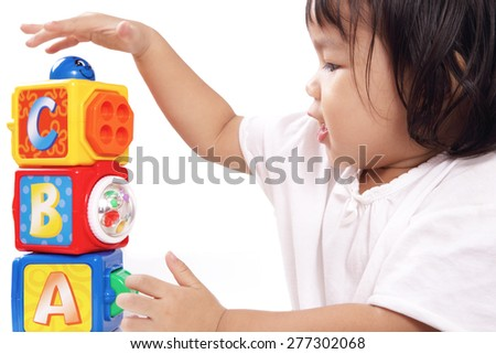 Asian Cute Baby Girl is Playing Stack of ABC Block Toys Isolated on White Background - stock photo