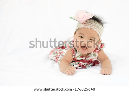 asian cute baby girl smile with big rose headband
