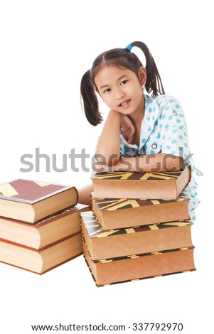 Asian cute girl smiling while lay on books.White background. Space on left.
