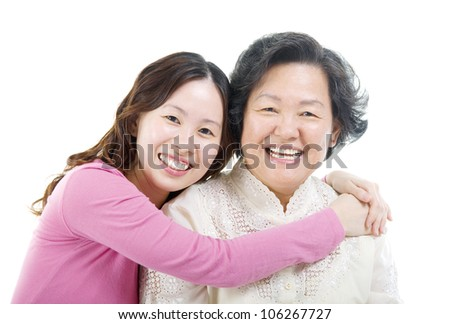 Asian daughter hugging her mother
