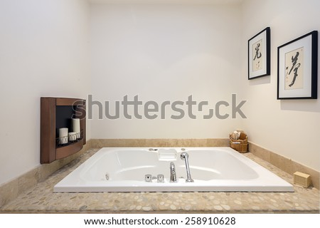 Asian decorated, Japanese bathroom , framed in bright stone.    - stock photo