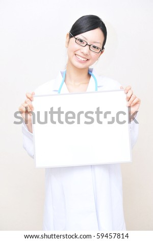 asian doctor holding a white board