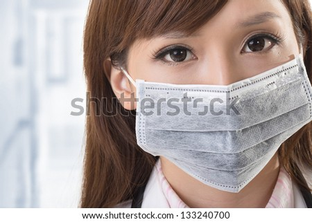 Asian doctor look at you, closeup portrait at hospital. - stock photo