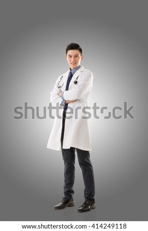 Asian doctor man, full length portrait isolated. - stock photo