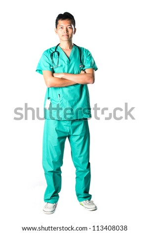 Asian doctor with arms crossed in green scrubs. Full length Portrait.  Isolated on White Background. - stock photo