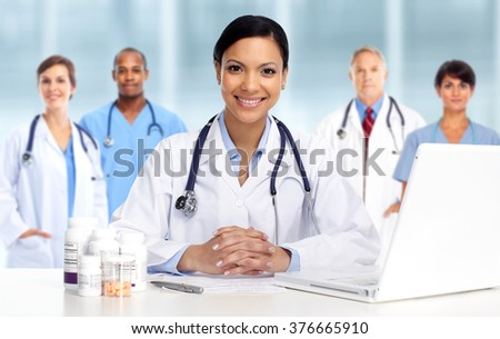 Asian Doctor woman with pills. - stock photo