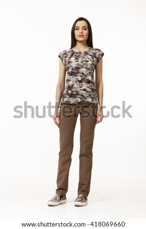 asian eastern brown hair business executive woman with straight hair style in khaki summer blouse  trainers trousers ked gumshoes going full body length isolated on white - stock photo