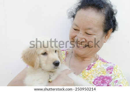 asian elderly and puppy - stock photo