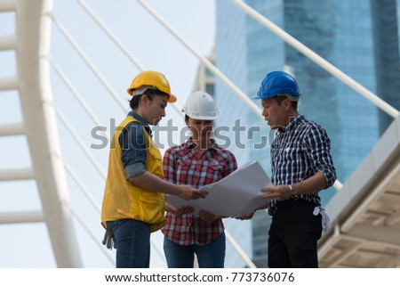Asian engineers group consult construction on stock photo royalty asian engineers group consult construction on site building working while holding blueprint paper in city malvernweather Images