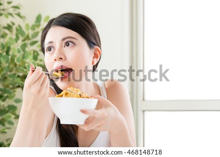 asian enjoy woman lose weight by eating cereal for breakfast, healthy lifestyle concept, indoor background
