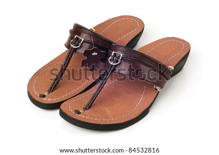 Asian especially malaysian and indonesian traditional footware create from leather isolated white background.