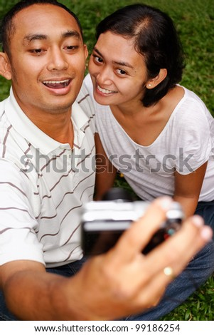 asian ethnic young couple happy taking self portrait