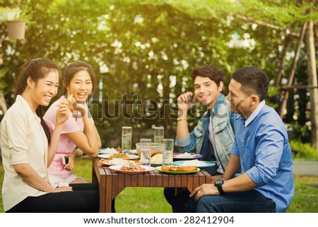 Asian ethnicity Having breakfast in the garden at home. Everyone laughed and enjoyed - stock photo