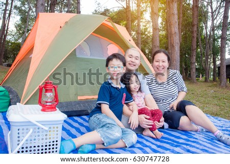 Asian family at camping site