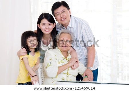 Asian family at home - stock photo