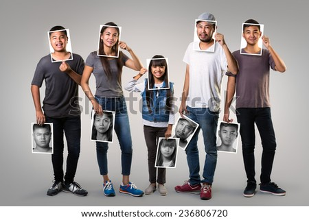 Asian family changing mood - stock photo