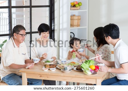 Asian family eating at home. Multi generation having meal, living lifestyle. - stock photo