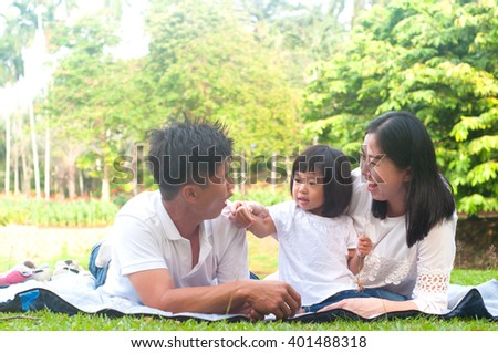 Asian family enjoying outdoor nature  - stock photo