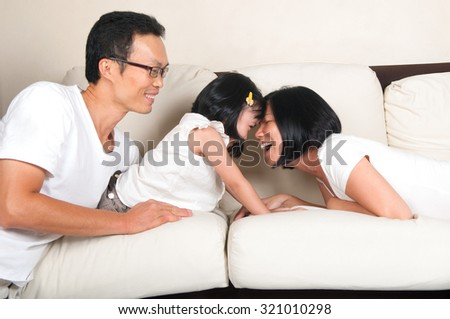 Asian family having fun at home - stock photo