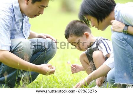 asian family having fun outdoor - stock photo