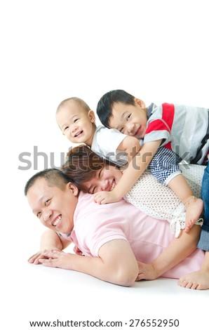 Asian family having piggyback fun  - stock photo