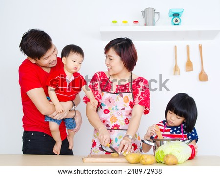 Asian family in the kitchen - stock photo