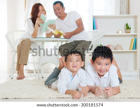 Asian family in the living room - stock photo