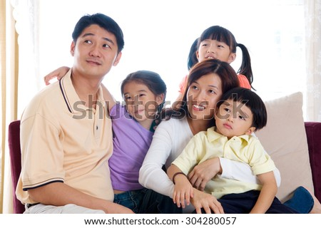 Asian family looking up
