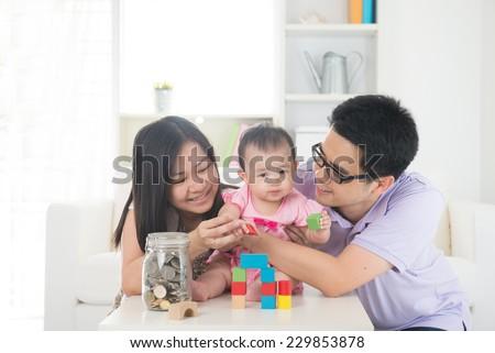 asian family money saving concept lifestyle photo - stock photo