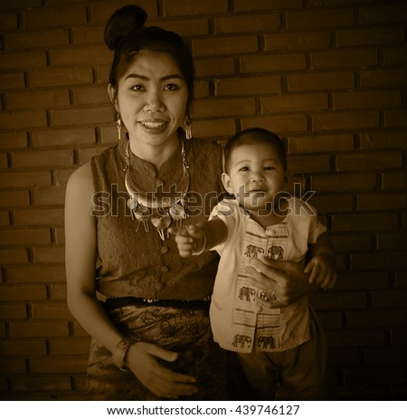Asian family, Mother holding her baby, hug, mom, fashion, Thai Lanna style, Vintage Style, black and white picture, Grayscale image, sepia color