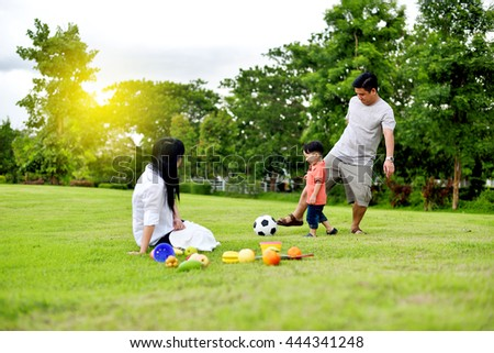 Asian family play together in the garden - stock photo
