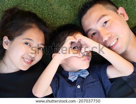 Asian Family portrait in public garden - stock photo