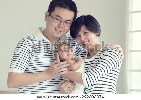 Asian Family portrait in studio house. - stock photo