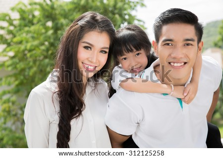 Asian family portrait with happy people smiling - stock photo