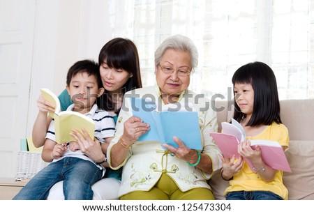 Asian family reading - stock photo