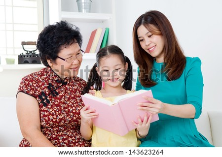 Asian family reading - stock photo