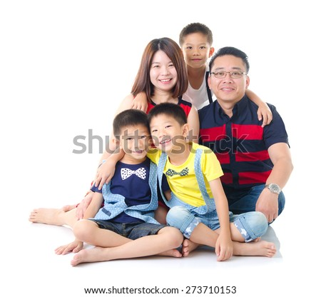 Asian family sitting on the floor