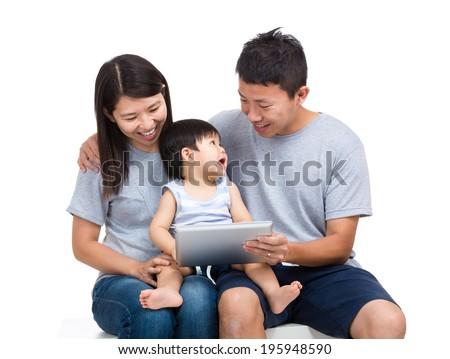 Asian family using tablet - stock photo