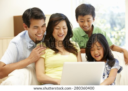 Asian family with laptop - stock photo