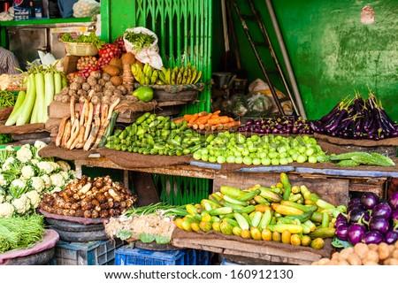 Asian farmer's market selling fresh vegetables - stock photo