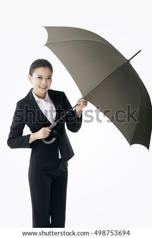 Asian fashion business woman holding an umbrella