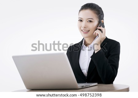 Asian fashion business woman using computer