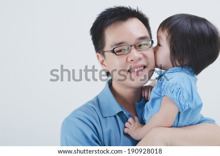 asian father and daughter on plain background - stock photo