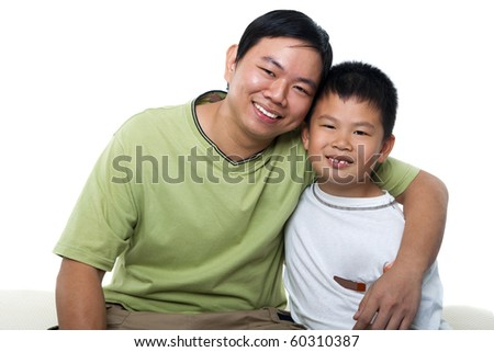 Asian father and son isolated on white - stock photo