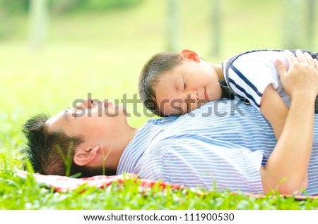 asian father bonding with son - stock photo