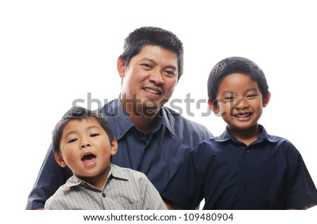 Asian father embracing his happy sons - stock photo