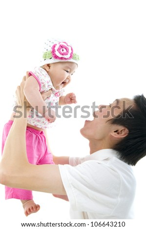asian father picking up his daughter - stock photo