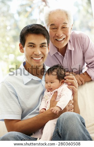 Asian father,son and granddaughter - stock photo